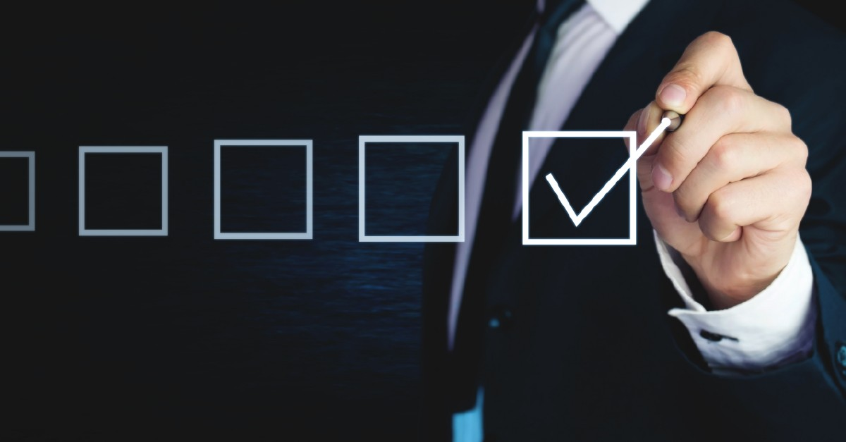 It shows a man in a black suite checking boxes as in a to-do checklist