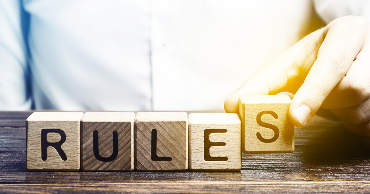 "The word ""rules"" is formed by letters written on individual cubes"