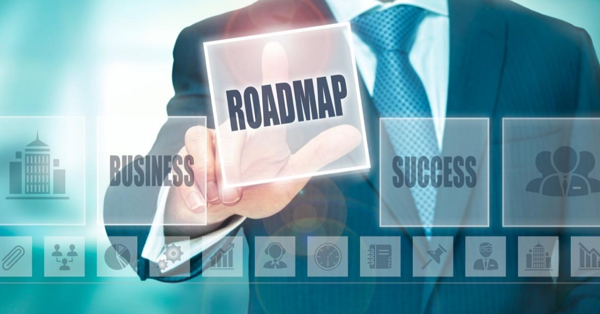 "Businessman touching a screen where it can be seen words like ""Business"" and ""Sucess"", he puts his finger upon the word ""Roadmap"""